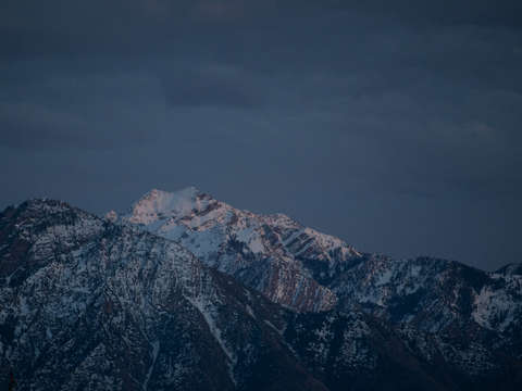 Snowy blue mountains at dusk