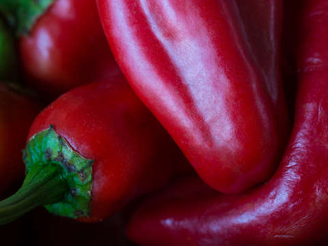 Red peppers embracing