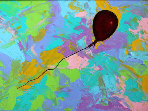 Red baloon in a pastel storm
