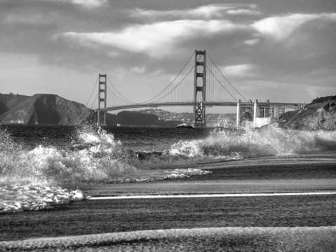 Splash at baker beach bw