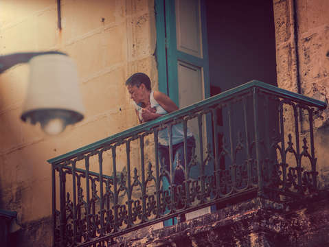 Lady on balcony in havana