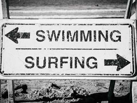 Surfing or swimming