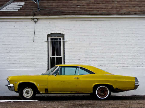 Old yellow impala