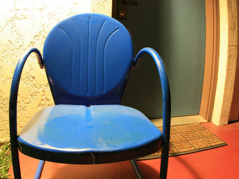 Old blue metal chair