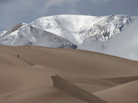 Great sand dunes and snow capped peaks