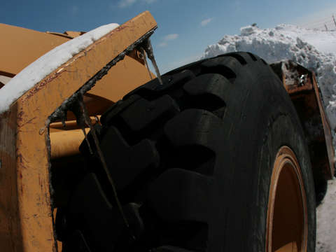 Front end loader in snow