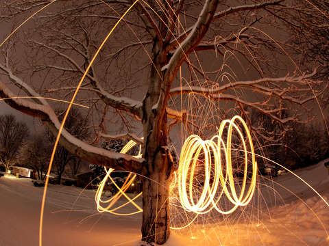 Spinning Steel Wool In A Snowy Yard