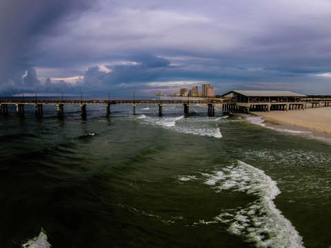Gulf state pier storm clouds
