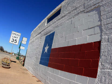 Texas flag painted on building