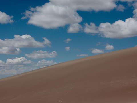 Big clouds over sand dunes