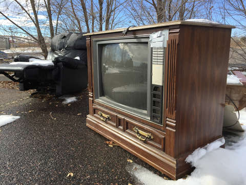 Old tv and recliner in the snow