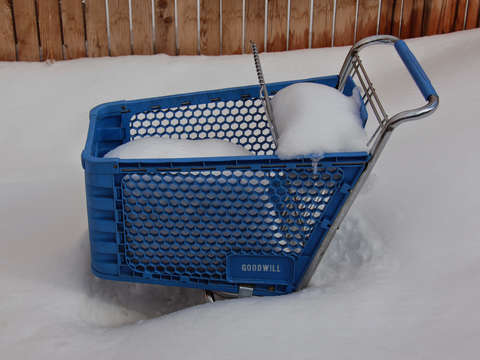 Goodwill shopping basket filled with snow