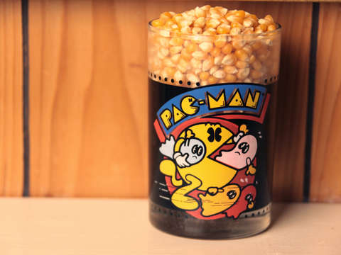 Pac man glass and popcorn kernels