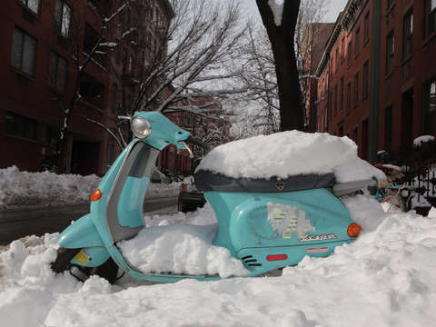 Snow covered scooter