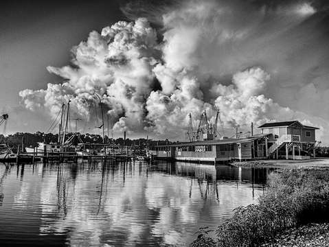 Building clouds on the bon secour river alabama bw