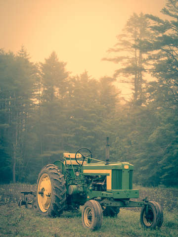 Old john deere tractor early morning fog