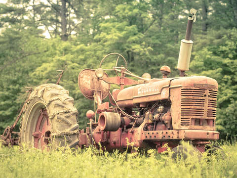Old farmall tractpr in the field