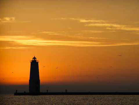 Sunset at frankfort north breakwater lighthouse