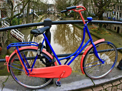 Blue and pink bicycyle in utrecht
