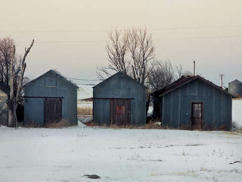 Three sheds in snow