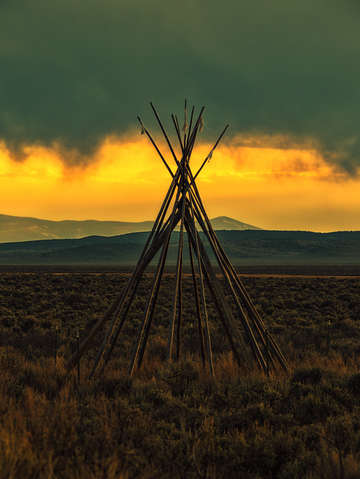 Teepee storm sunset