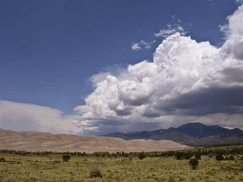 Clouds rolling over great sand dunes national park