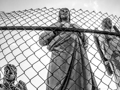 Jesus behind a fence