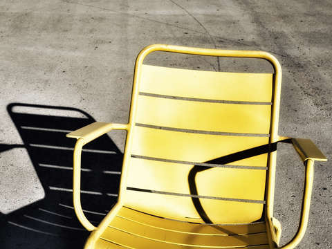The yellow chair and its shadow
