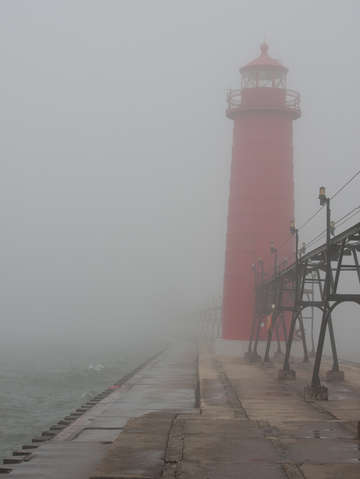 Lighthouse in thick lake michigan fog