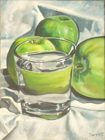 Waterglass with green apples