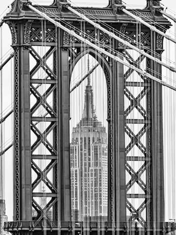 Empire state building framed by manhattan bridge 8
