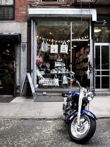 Motorcycle and pretty store