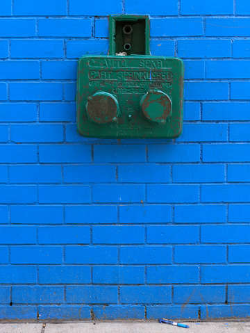 Blue wall and a blue pen harlem nyc new york