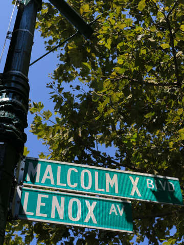 Street sign malcolm x blvd harlem nyc new york