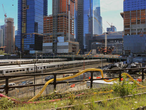 Snaking tube along the highline by a rail yard in