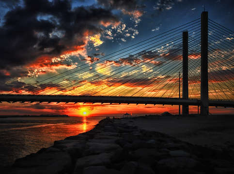 Sunset bridge at indian river inlet