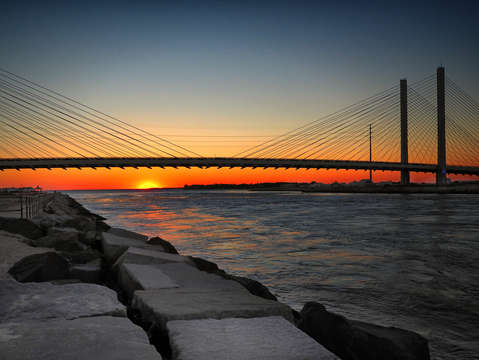Sunset under the indian river inlet bridge