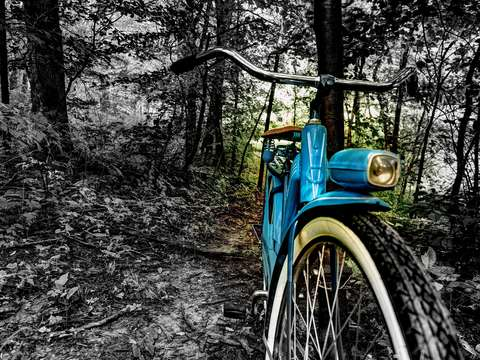 The old blue bike on the trail
