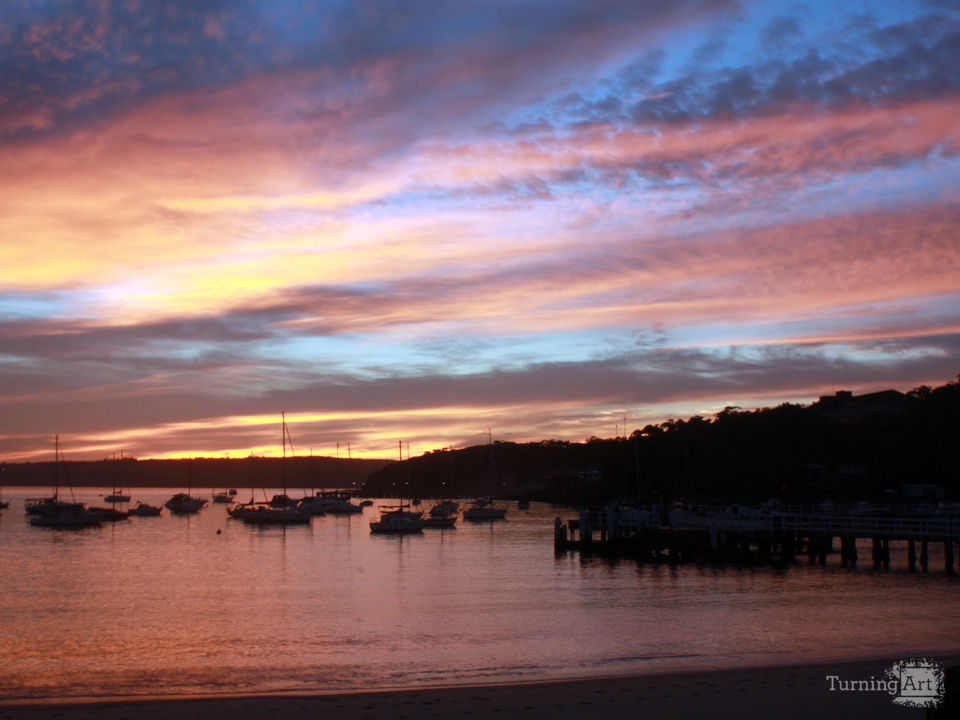 Australia balmoral beach at sunset boats in the ha