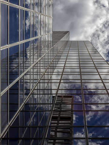 Reflective office building sky and clouds