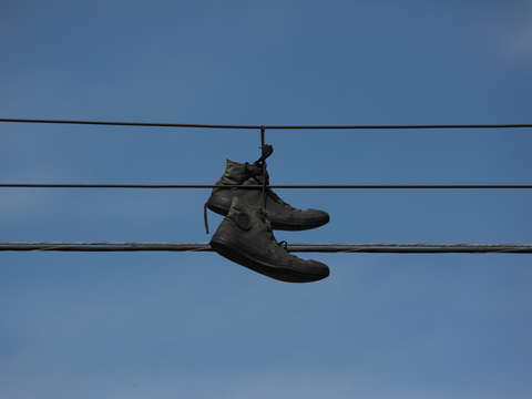 Black shoes on a wire