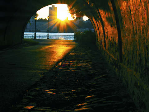 Underpass view of a hudson river sunset