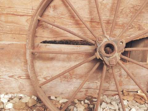 Wagon wheel on barn