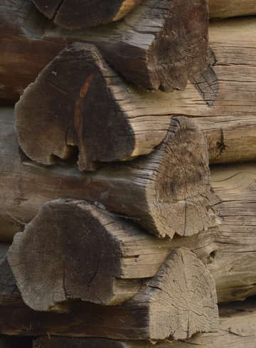 Old handcrafted logs on barn