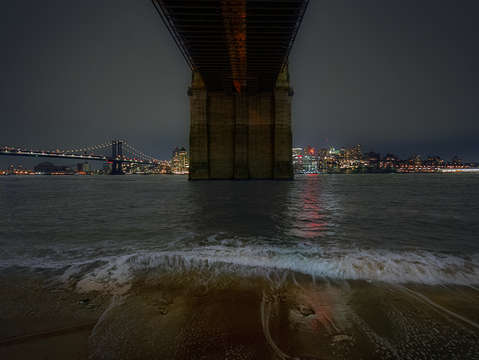 Waves crashing under the brooklyn bridge