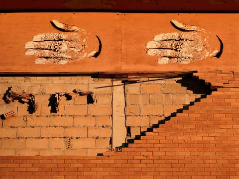 Hands and bricks 12