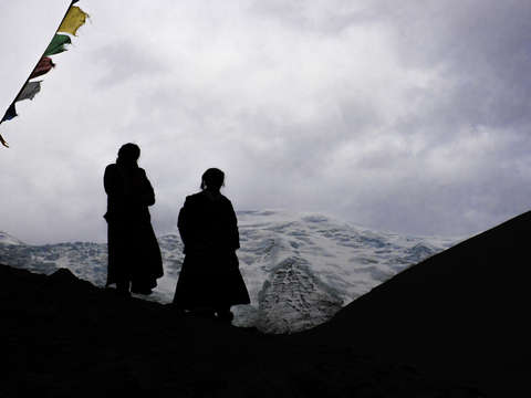 Silhouetted women on tibetan plateau