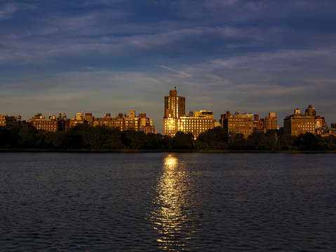 Central park reservoir at sunset looking east