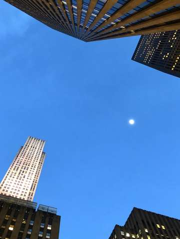 Skyscraper and a moon manhattan new york