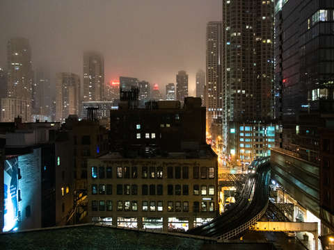 Chicago train with skyline on a foggy night